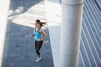 Woman running through urban setting