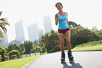 Woman rollerblading in urban park