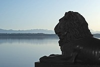 Lion Statue with Alps
