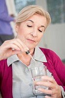 Close_up of a woman taking medicine