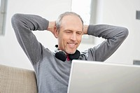 Man looking at a laptop and smiling