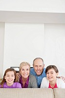 Couple smiling with their granddaughters