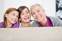 Portrait of a woman smiling with her granddaughters