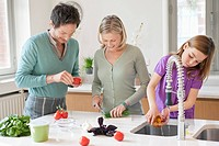 Family preparing food in the kitchen (thumbnail)