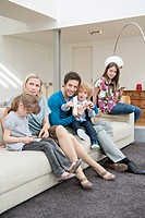 Family in a living room (thumbnail)