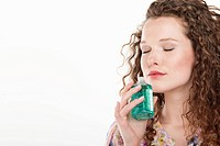 Woman smelling aromatherapy oil (thumbnail)