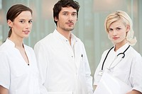 Portrait of three doctors standing together (thumbnail)