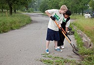 Detroit, Michigan - Volunteers clean up Eliza Howell Park, cutting weeds, clearing trash, and removing invasive plants