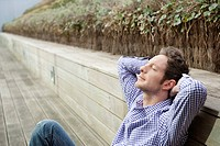 Man resting on a boardwalk