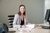 Businesswoman doing paperwork in an office