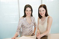 Businesswomen smiling in an office