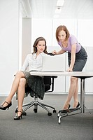 Two businesswomen working in an office