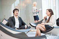 Business executives sitting on chairs in a waiting room