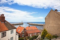 View toward Whitby's two piers and harbour entrance Whitby North Yorkshire England UK