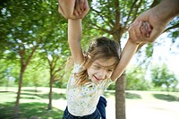 Little girl being swung through air by her arms (thumbnail)