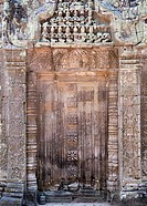 Cambodia - Blind door in the Hall of the Dancers at the Ta Prohm temple in Angkor  The temple complexes of Angkor ´city´ were the heart of the Khmer e...