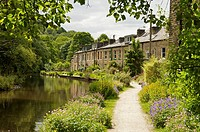 Stone built terraced houses on the banks of the rochdale canal at Hebden Bridge,West Yorkshire