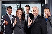 Business team doing OK sign