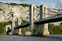 Suspended bridge over the Rhone river with cliffs in the background, Drome, France.