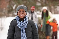 African American boy smiling outdoors in snow
