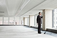 Businessman on telephone in empty office