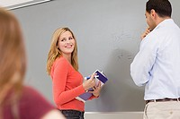High schcool teacher and student using white board