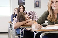 Male high school student asleep in class