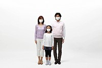 Parents and their daughter wearing surgical masks