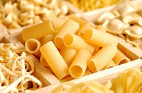 Compartment of rigatoni in a box containing a wide variety of different pasta