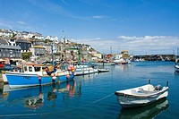 Boats in the harbour at Mevaggisey Cornwall England