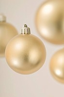 Several gold Christmas baubles