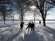 England, Oxfordshire, Radley. Children playing in the snow in Radley Village.