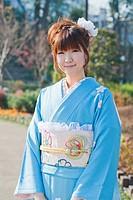 Japan, Tokyo, Pretty Japanese woman in a blue kimono.