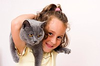 Girl, 6 years old, with British Shorthair Cat, blue