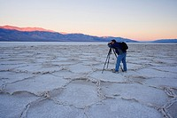 Photographer at sunrise over Badwater, Death Valley national park