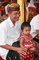 Indonesia, Bali, Mas, temple festival, people, odalan, Kuningan holiday, father with daughter,