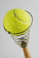 Close_up of a tennis ball on an egg beater