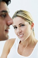 Close_up of a mid adult woman with a face of a mid adult man in front of her