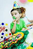 Boy eating candy at a birthday party