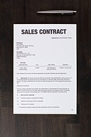 A sales contract and a pen