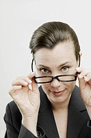 Portrait of a businesswoman adjusting her eyeglasses