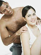 Close_up of a mid adult man massaging a young woman´s shoulders
