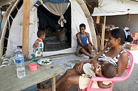 family people timor leste in front tent camp for