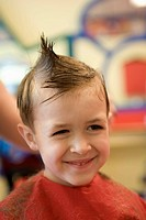 kid young boy smiles gets hair cut haircut salon