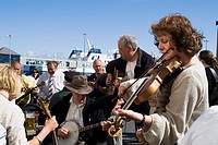 Stromness Folk Festival STROMNESS ORKNEY Musicians group playing banjo violin and guitars instruments