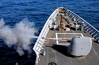 091227-N-2600H-014 GULF OF ADEN Dec  27, 2009 The 5-inch/54-caliber Mk 45 lightweight gun of the guided-missile cruiser USS Chosin CG 65 is fired duri...