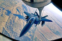 An F-15E Strike Eagle refuels over the mountains of Afghanistan  The F-15E provides close-air support and armed aerial overwatch to deter enemy activi...