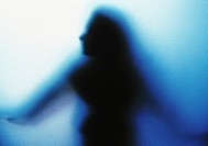 Blurred silhouette of woman