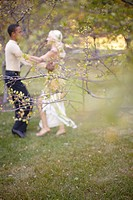 inter_racial couple dancing in park