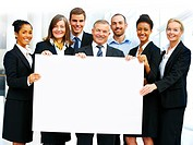 Portrait of a diverse business group holding a white board Blank board
